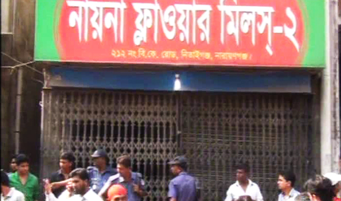 Police visit Nayna Flower Mills in Narayanganj town after two employees of the mill were found dead there on Sunday. Photo: TV grab