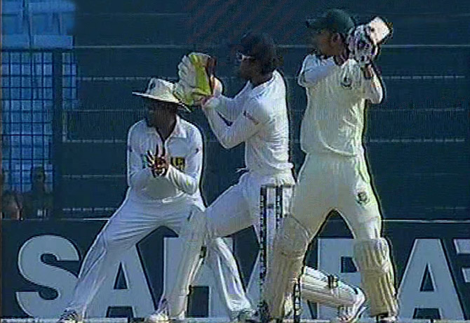 Nasir Hossain hits a boundary on the off-side as he tries to guide Bangladesh to safety following another top order collapse against Sri Lanka on the third day of the Chittagong Test. Photo: TV grab