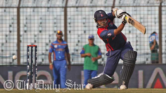 SP Khakurel of Nepal hits a boundary on in Nepal's total of 141 as they beat Afghanistan by 9 runs in Thursdaty's match of the World T20 in Chittagong. Photo: Firoz Ahmed