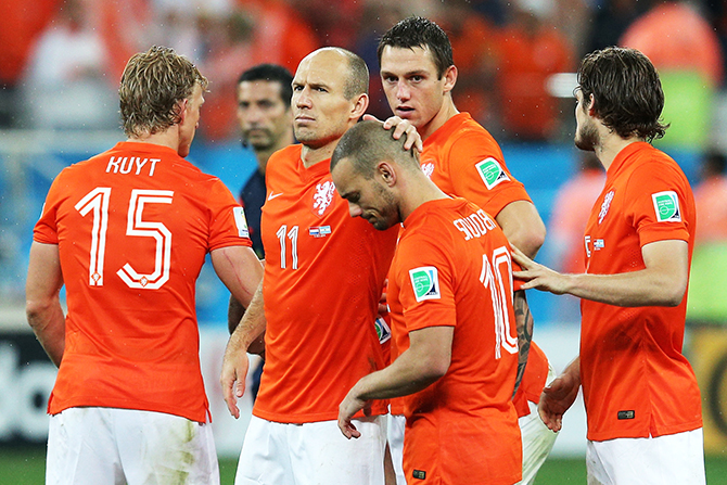 Wesley Sneijder and Arjen Robben of the Netherlands react with teammates after being defeated in a penalty shootout by Argentina during the 2014 FIFA World Cup Brazil Semi Final match between the Netherlands and Argentina at Arena de Sao Paulo on July 9, 2014 in Sao Paulo, Brazil. Photo: Getty Images