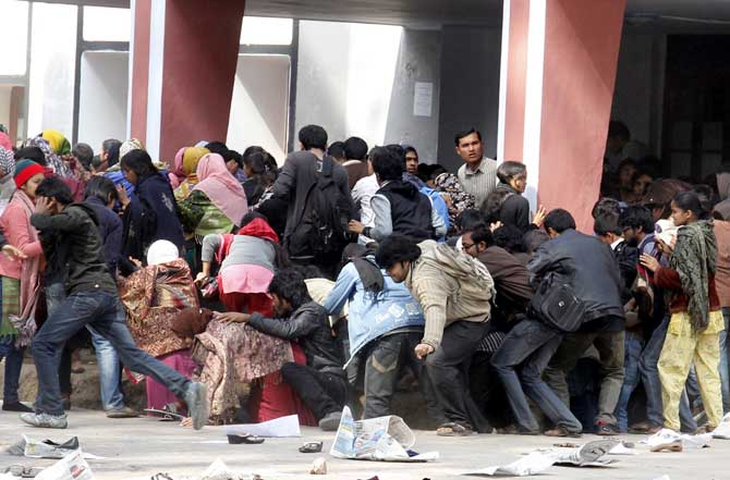 This February 2 photo shows, shocked with fear, Rajshahi University students retreating as police and Bangladesh Chhatra League opened fire on them during a demonstration. Star file
