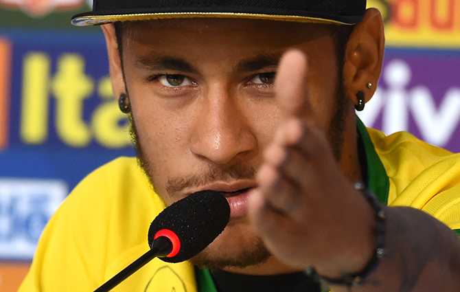 Brazil's forward Neymar gestures during a press conference in Teresopolis on July 10, 2014, during the FIFA World Cup. Brazil will face Netherlands on July 12, in the third place play-off for the FIFA World Cup tournament at The Mané Garrincha National Stadium in Brasilia. Photo: AFP/ Getty Images