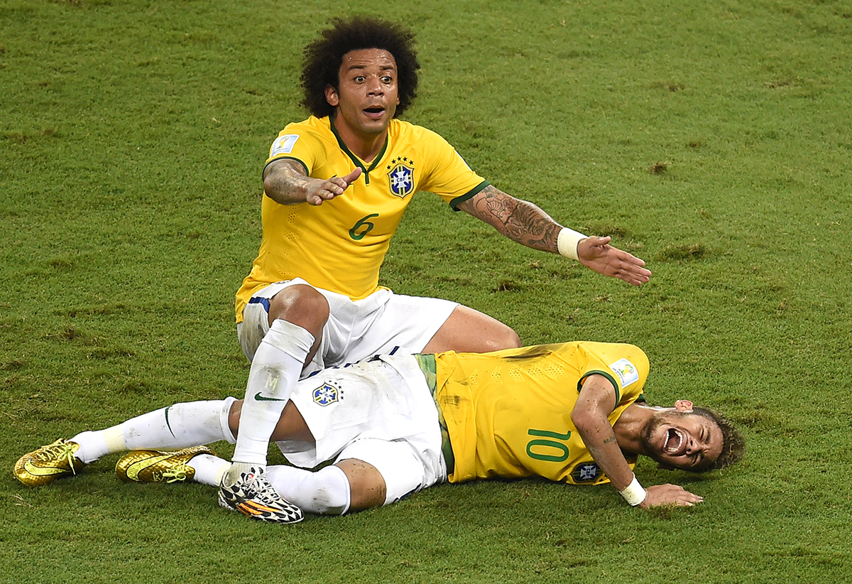 Defender Marcelo shouts for help after Brazil's forward Neymar was injured during the quarter-final football match between Brazil and Colombia at the Castelao Stadium in Fortaleza during the 2014 FIFA World Cup on July 4, 2014. Photo: AFP/ Getty Images