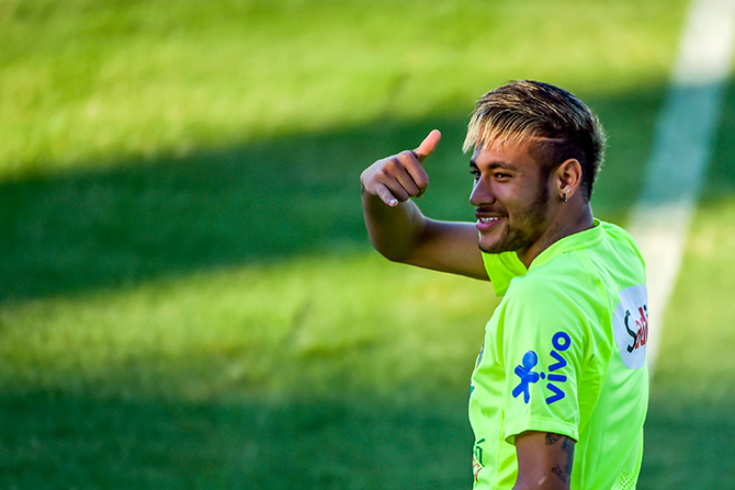 Neymar gestures during a training session at the President Vargas stadium on the eve of the FIFA World Cup 2014 quarter-final match between Brazil and Colombia in Fortaleza on July 3, 2014 in Fortaleza, Brazil. Photo: Getty Images