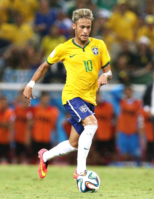 Neymar Jr. of Brazil runs with the ball during the Group A match of the 2014 World Cup between Brazil and Mexico at the Estadio Castelao on June 17, 2014 in Fortaleza, Brazil. Photo: Getty Images