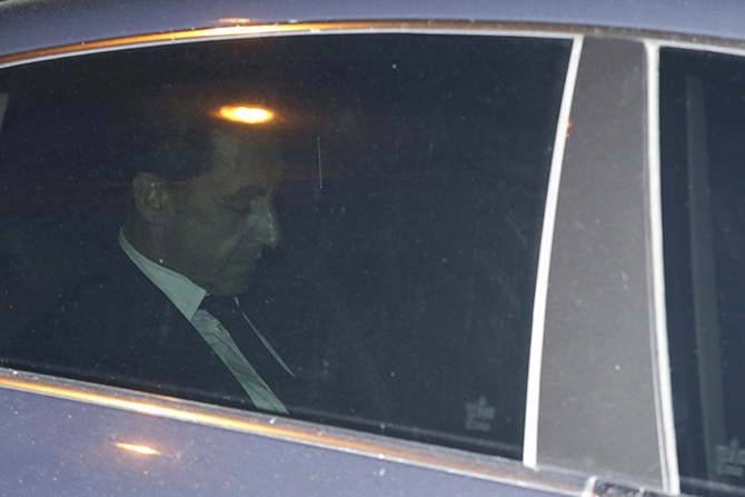 Former French President Nicolas Sarkozy leaves the financial crimes section, on July 2, 2014 in Paris. Nicolas Sarkozy was detained for questioning in a widening corruption probe, a judicial source said, in an unprecedented move against a former French president. Sarkozy had turned himself in for questioning a day after investigators detained his lawyer Thierry Herzog and two magistrates. Photo: Getty Images