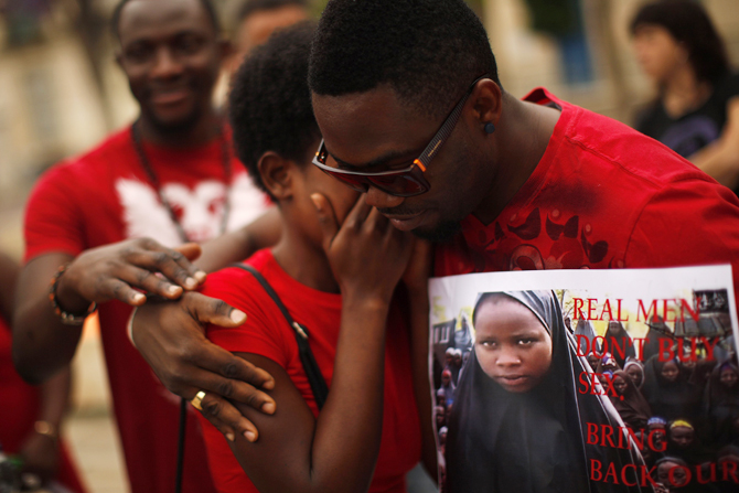 A Nigerian woman is comforted by a man as they take part in a protest, called by Malaga's Nigerian women Association, for the release of the abducted secondary school girls from the remote village of Chibok in Nigeria, at La Merced square in Malaga, southern Spain May 13, 2014. Photo: Reuters