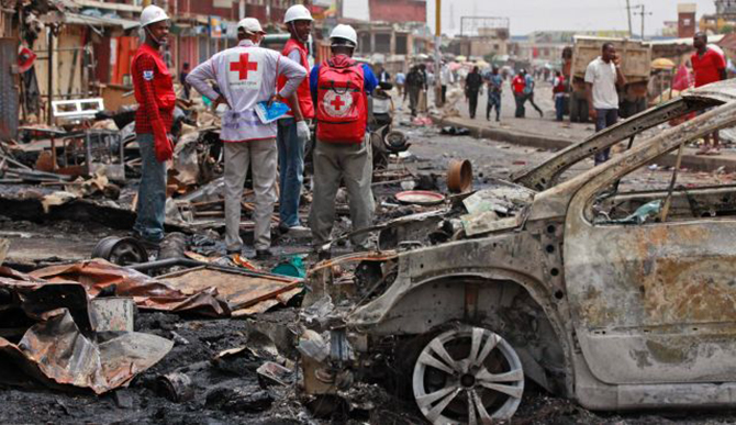 Red Cross personnel search for remains at the site of a Boko Haram car bomb attack in Jos, Nigeria on May 21. Photo: AP