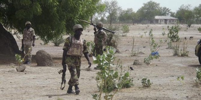 Soldiers patrol northern Nigeria in this photo from last June. Violence has longed plagued the area, and more than 100 were killed this week by gunmen on motorcycles. Photo: Reuters