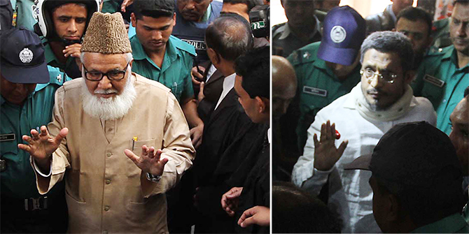 Law enforcers take former ministers Lutfozzaman Babar (R) and Motiur Rahman Nizami among the 11 accused in the sensational 10-truck arms haul cases to a Chittagong court Thursday morning. 14 people including NIzami, Babar and Ulfa leader Paresh are sentenced to death in the case filed under the Special Powers Act, 1974 for smuggling firearms.