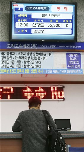 A passenger gets a refund of his ticket for Yeonpyeong island in the western sea at Incheon port passenger terminal in Incheon, west of Seoul, South Korea on Tuesday. Photo: AP