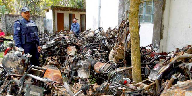 This file photo shows wreckage of 39 burnt motorbikes of the activists of Awami League and its front organisations, bearing testimony to the extent of barbaric attack on a December 14 march led by AL lawmaker Asaduzzaman Noor near Ramganj, eight km off Nilphamari town, is kept on the premises of Nilphamari Sadar Police Station.