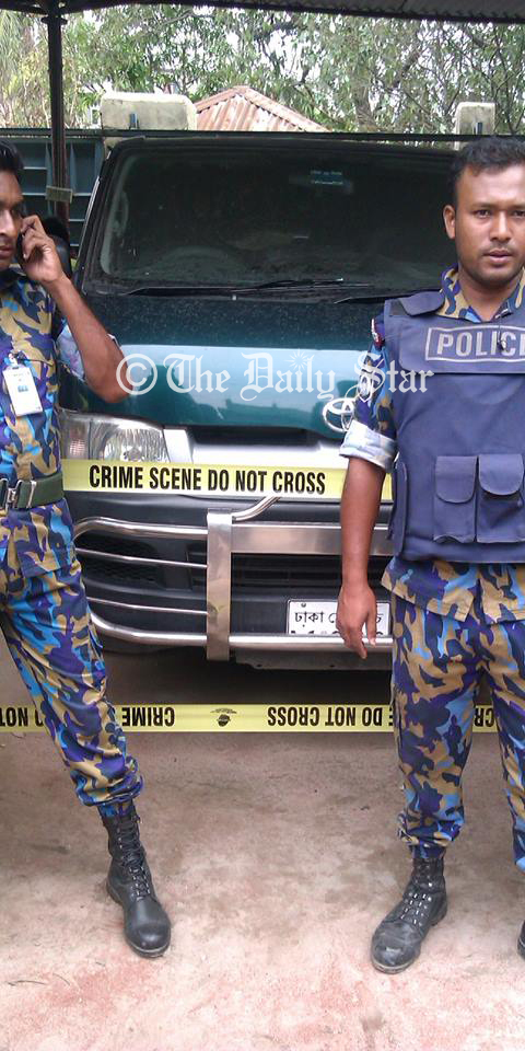 Law enforcers seize a microbus at the house of a local Awami Legaue leader Nur Hossain at his Tekpara residence in Siddhirganj, Narayanganj on Saturday. Photo: Shaheen Mollah