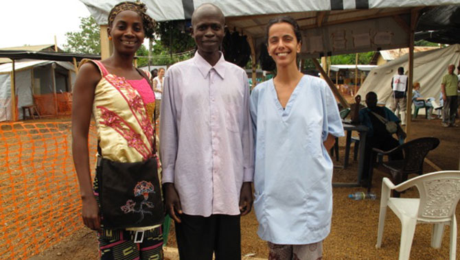 Nurse Monia Sayah (R) standing with a recovered patient and the nurse supervisor at the Doctors Without Borders facility in Guinea where she treated Ebola patients. Photo taken from CBS News