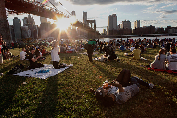 People wait to watch the annual Macy's fourth of July fireworks show looking over the East River on July 4, 2014 in the Brooklyn borough of New York City. Photo: Getty Images