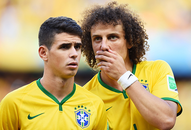 Oscar (L) and David Luiz of Brazil look on during the 2014 FIFA World Cup Brazil Quarter Final match between Brazil and Colombia at Castelao on July 4, 2014 in Fortaleza, Brazil. Photo: Getty Images