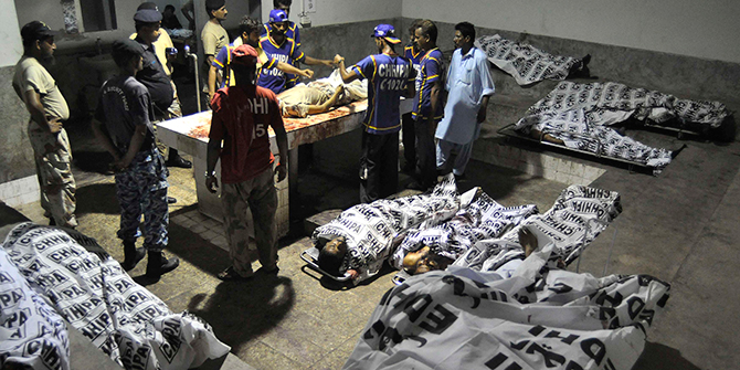 Rescue workers and paramilitary soldiers gather next to bodies after an attack on Jinnah International Airport, at a hospital morgue in Karachi June on Monday. Gunmen attacked one of Pakistan's biggest airports on Sunday and at least 23 people were killed, including all 10 of the attackers, media reported. Photo: Reuters