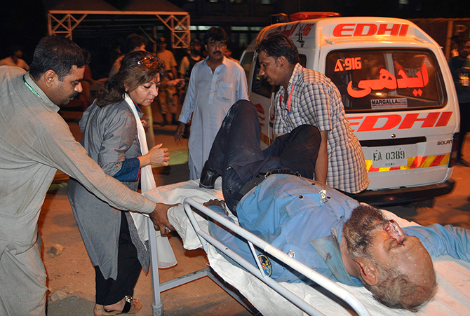 Paramedic staff move an Airport Security Force (ASF) official, who was wounded in an attack at Jinnah International Airport, outside Jinnah hospital in Karachi on Monday. Gunmen attacked one of Pakistan's biggest airports on Sunday and at least 23 people were killed, including all 10 of the attackers. Photo: Reuters