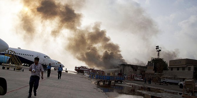 Smoke rises above Karachi airport terminal in Pakistan on Monday. Photo: AP