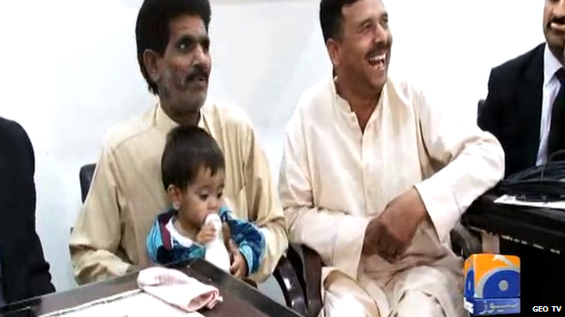 Pakistani media aired footage of baby Musa sitting on his father's lap drinking milk in his first court appearance. Photo taken from BBC