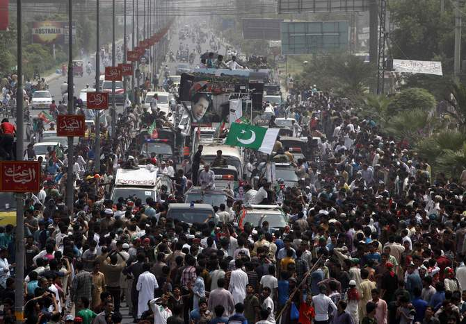 Supporters of cricketer-turned-opposition politician Imran Khan take part in the Freedom March in Gujranwala August 15, 2014. Clashes broke out Friday as tens of thousands of Pakistani protesters from two anti-government movements converged on the capital, presenting the 15-month-old civilian government with its biggest challenge yet. Photo: Reuters