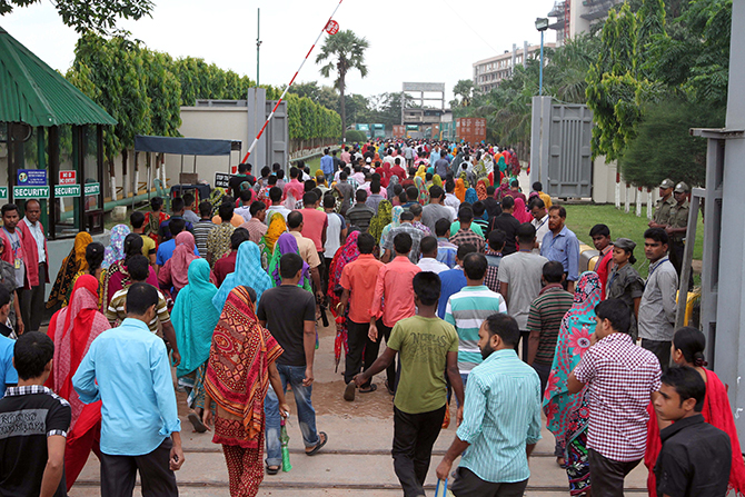 Amid strike call, garment workers are joining workplace today August 9, 2014 at a garment factory in Ashulia, outskirt of Dhaka. Photo: Palash Khan