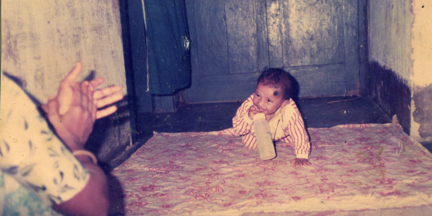 This old photo from the family album shows mother Laily clapping so that her infant son Rajib smiles for the camera. A year and a half later, Rajib died after he was given toxic paracetamol syrup. Photo: Courtesy of Laily Begum.