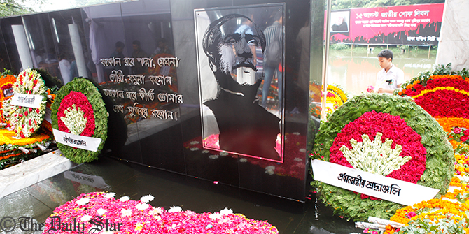 The wreaths are placed by President and Prime Minister at the portrait of Bangabandhu in the Bangabandhu Memorial Museum at Dhanmondi of Dhaka on Friday to mark the National Mourning Day. Photo: Rashed Suman