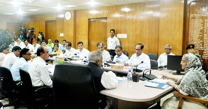 Prime Minister Sheikh Hasina holds a meeting with Industries Minister Amir Hossain Amu and other officials at the ministry on Sunday. Photo: BSS