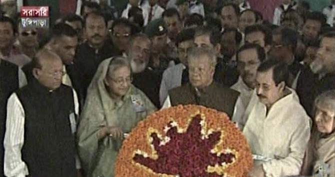 Prime Minister Sheikh Hasina, also the president of Awami League, place wreath at the grave of Father of the Nation Bangabandhu Sheikh Mujibur Rahman on behalf of the party in Tungipara of Gopalganj Monday. Photo: TV grab
