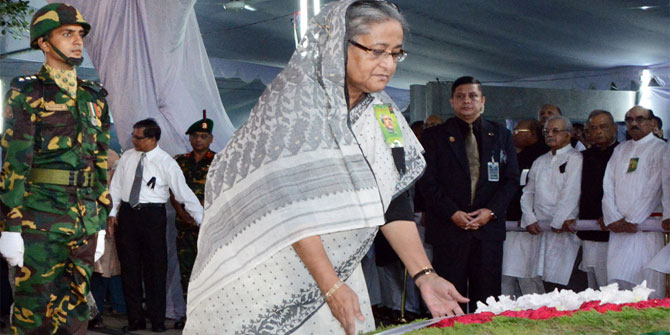 This August 15, 2013 photo shows Prime Minister Sheikh Hasina placing floral wreath at the portrait of Bangabandhu Sheikh Mujibur Rahman at Bangabandhu Memorial Museum in the city's Dhanmondi marking his death anniversary.