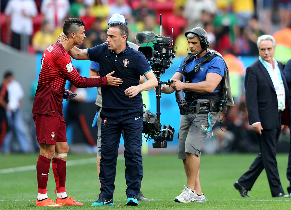 Head coach Paulo Bento of Portugal consoles Cristiano Ronaldo after the 2014 FIFA World Cup Brazil Group G match between Portugal and Ghana at Estadio Nacional on June 26, 2014 in Brasilia, Brazil. Photo: Getty Images