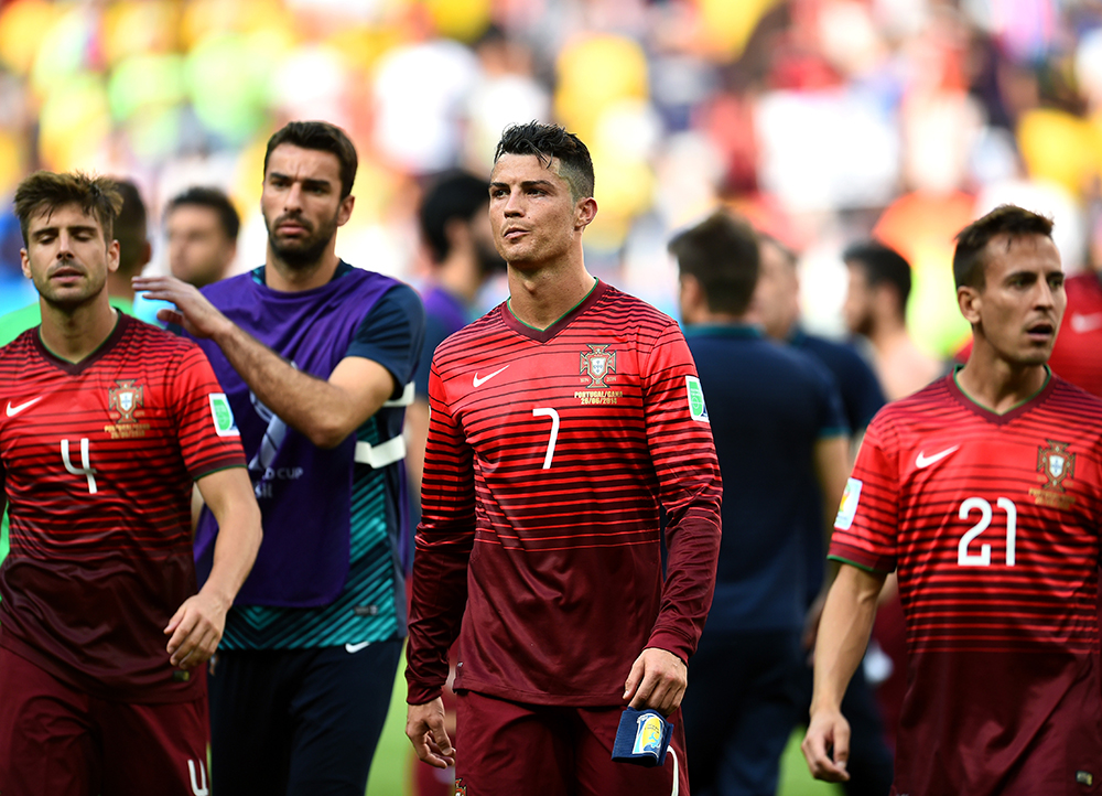 (L-R) Miguel Veloso of Portugal, Cristiano Ronaldo of Portugal and Joao Pereira of Portugal show their dejection after the 2014 FIFA World Cup Brazil Group G match between Portugal and Ghana at Estadio Nacional on June 26, 2014 in Brasilia, Brazil. Photo: Getty Images
