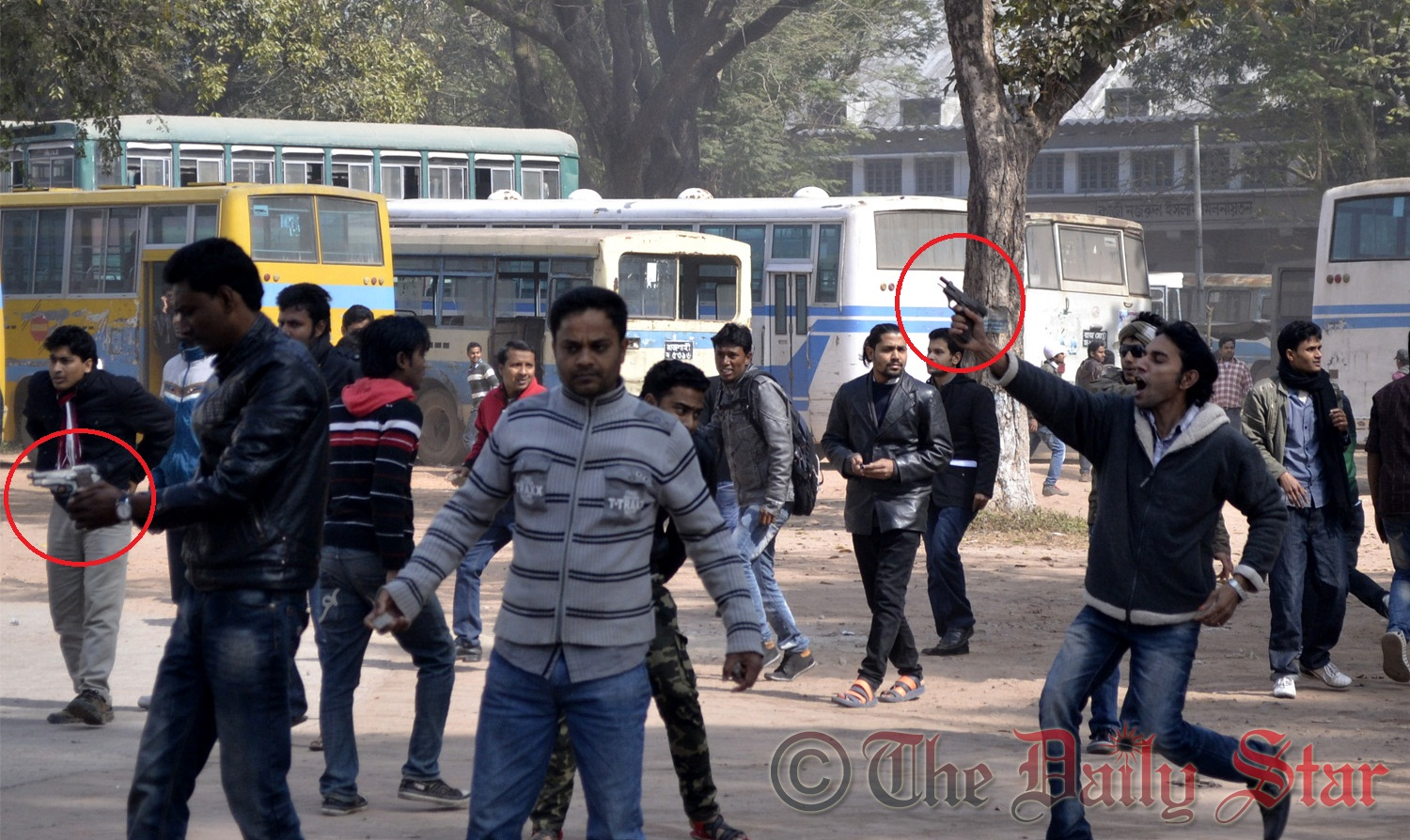 Alleged Bangladesh Chhatra League activists, armed with guns (red-circle marked), wield weapons while chasing the demonstrating students of Rajshahi University on Sunday. Photo: STAR