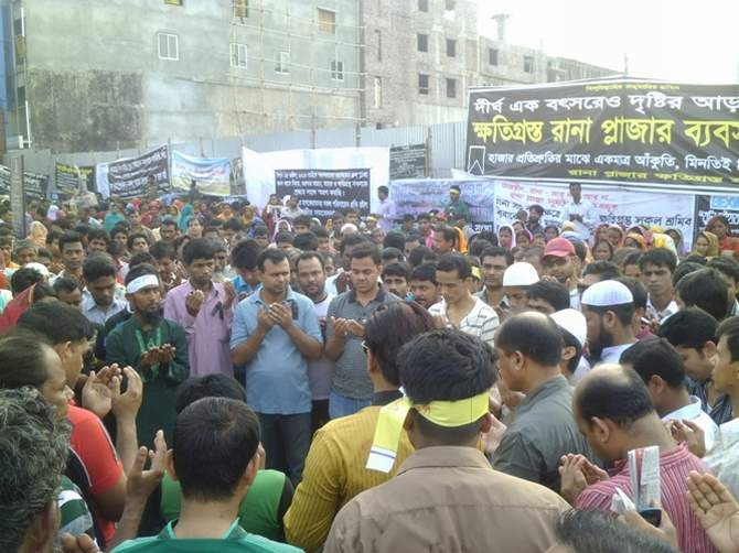 Relatives of Rana Plaza victims and garment workers offer munajat on Dhaka-Aricha highway at Savar Thursday morning marking a year of the building's tragedy that took place on April 24, 2013. They block the highway for four hours today. Photo: STAR