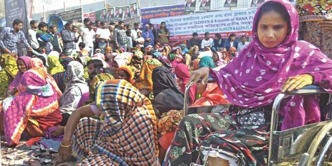 This December 24 photo shows victims of Rana Plaza collapse and their relatives demonstrating for compensation at the disaster site in Savar. Star file photo