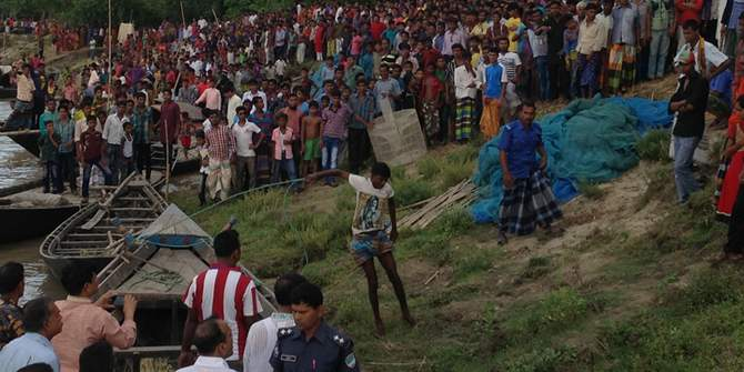 People gather on the bank of the Padma river in Daulatpur upazila of Kushtia after 11 people went missing in a boat capsize in the river Tuesday afternoon.
