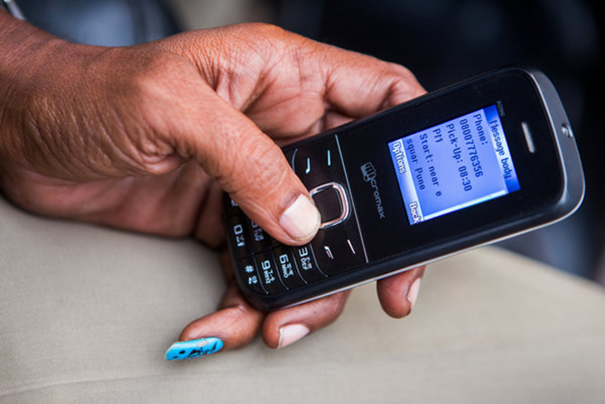 Dusane receiving a text message with details of a pickup. Photo: The New York Times