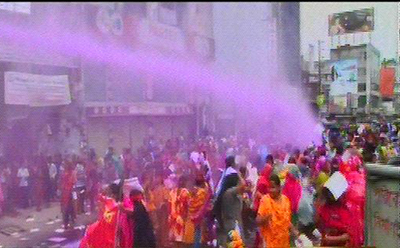 Law enforcers use water cannons to disperse the demonstrating workers of Toba group. Photo: TV grab