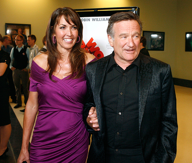 "Actor Robin Williams (R), star of the film ""World's Greatest Dad"", escorts Susan Schneider at the film's premiere in Los Angeles, California in this file picture taken August 13, 2009. Photo: Reuters"