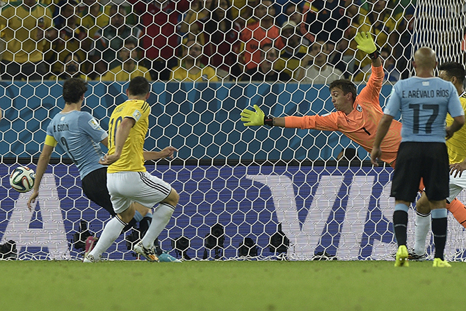 Colombia's Colombia's midfielder James Rodriguez (2nd L) scores his second goal against Uruguay during a Round of 16 football match at the Maracana Stadium in Rio de Janeiro during the 2014 FIFA World Cup on June 28, 2014. Photo: Getty Images