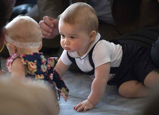 Prince George, son of Britain's Prince William and his wife Catherine, the Duchess of Cambridge, looks at other babies during a Plunket nurse and parents group event at the Government House in Wellington April 9, 2014. Photo: Reuters