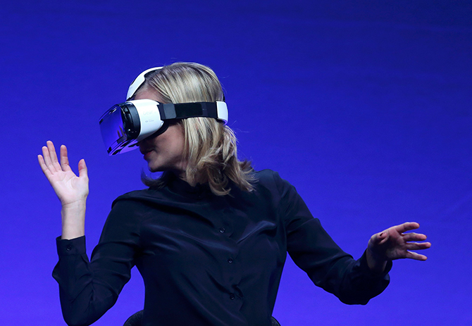 Television presenter Rachel Riley tries the new Samsung Gear VR device at the Unpacked 2014 Episode 2 event ahead of the IFA Electronics show in Berlin, September 3, 2014. Photo: Reuters