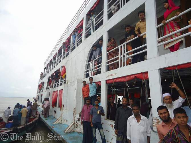 Passengers of stuck MV Sattar Khan are being rescued with help of trawlers and another launch on Saturday. 1,165 passengers of the launch that got stuck in Meghna river after hitting a hidden shoal in Haim Char upazila of Chandpur last night, were rescued after 14 hours. Photo: STAR
