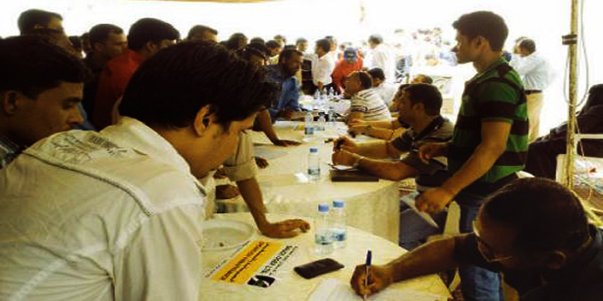 This file photo shows Bangladeshi workers crowd counters of companies participating in a job fair organised by Bangladesh embassy in Riyadh.