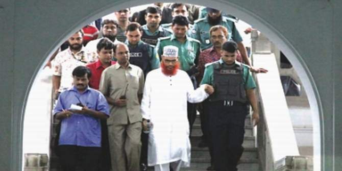 In this Star photo taken on September 21, 2010, Jamaat-e-Islami Nayeb-e-Amir Delawar Hossain Sayedee is leaving a war crime tribunal after a session amid strict security.