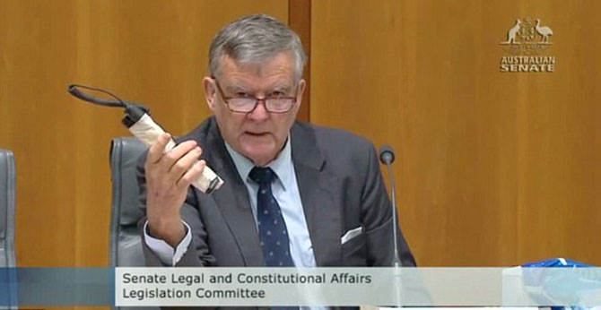 Liberal Senator Bill Heffernan shows a 'pipe bomb' into Parliament during a Senate Committee meeting to highlight flaws in the security arrangements at Parliament House in Canberra. Photo: Mail Online