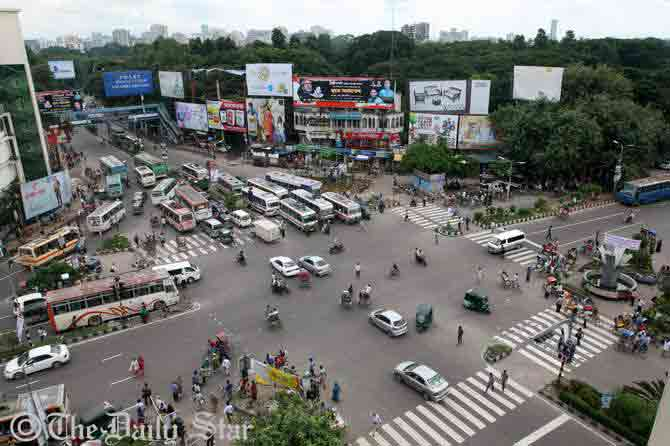The aerial view shows few vehicles at Shahbagh intersection in Dhaka on Sunday's office rush hours during eight-hour hartal (shutdown) enforced by Islami Chhatra Sena across the country. The roads at the intersection usually remain too busy in other working days. Photo: Palash Khan