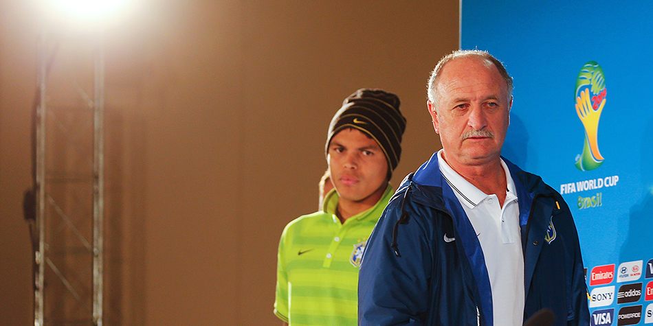 Brazil's coach Luiz Felipe Scolari (R) and defender and team captain Thiago Silva arrive to hold a press conference at the Mane Garrincha National Stadium in Brasilia on July 11, 2014 on the eve of the 2014 FIFA World Cup football match for third place between Brazil and the Netherlands. Photo: Getty Images