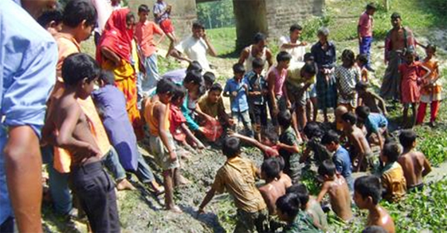 Villagers gatrher at a pond in Ziapur village in Khetail upazila of Joypurhat on Tuesday. Photo courtesy by Prothom Alo